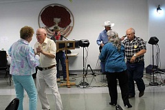 JASON CHANEY/CENTRAL OREGONIAN - Visitors enjoy dancing to live music by Just 4 Fun Band at the Prineville Senior Center Wednesday morning. Dancers pictured left to right are Elsie Andersen, Ben Oaks, Jessica Eaton and Roger Cusick. Band members pictured left to right are John Schultz and Frank Borden.