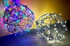 COURTESY PHOTO - Two oversized light ornaments from the 2015 Let it Glow project. Volunteers made 30 of the ornaments to hang in the Columbia Courthouse plaza in December.