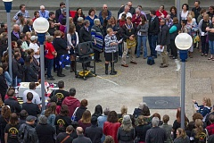 CONTRIBUTED PHOTO - Mt. Hood Community College President Debra Derr (in black and white at microphone) welcomes people to the ceremony for the time capsule that will be opened on MHCC's 100th anniversary in 2066. The capsule is at left of photo on the able.