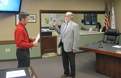 COURTESY PHOTO - City Recorder Greg Dirks, left, leads the oath of office administered to Councilor Mark Clark on Tuesday, Sept. 13 at Wood Village City Hall.
