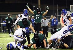 DAN BROOD - Tigard junior Jake Leavitt puts his arms in the air after sophomore Spencer Smith scored a touchdown in the 51-21 win over Newberg.