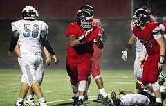 TIMES PHOTO: MILES VANCE - Westview's Brandon Pili celebrates a sack during his team's 48-22 win over Century at Westview High School on Friday.