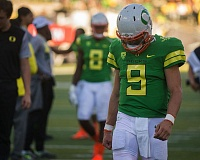 TRIBUNE PHOTO: JOSH KULLA - Oregon Ducks quarterback Dakota Prukop leaves the field after Saturday's loss to Colorado.