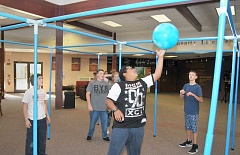 SETH GORDON - A group of middle school students play a game of '9 Square in the Air' at Newberg Christian Church's MyZone after school program, which hosts about 80 middle school students each weekday afternoon.