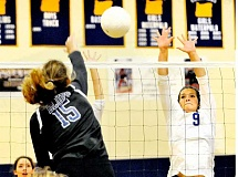 SETH GORDON - Middle blocker Peyton Thompson rises to block a shot during Newberg's 3-1 home loss to St. Mary's Academy Sept. 22.