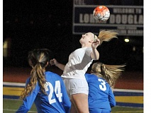 SETH GORDON - After missing each of the last two seasons with injuries, senior Jodi Luft flicks the ball on during Newberg's 0-0 draw versus Barlow Sept. 20.