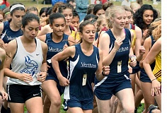SETH GORDON - Chloe Wassei and Madison McChesney (at center) lead the pack of Veritas runners at the start of the Bridgette Nelson Memorial Invitational Friday in The Dalles.