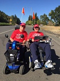 CONTRIBUTED PHOTO - Sam Beekman, left, rides with his friend during the second annual Wheelchair Trek for ALS earlier this September. Their shirts read 'Rolling Machines,' a reference to 'Running Machines,' the team name Beekman used when competing in Hood to Coast in healthier days.