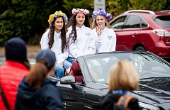 ADAM WICKHAM/FOR THE REVIEW - Senior homecoming princesses wave from a convertible in Lake Oswego High School's homecoming parade on Friday. From left: Iola Humphrey, Mahtaab Sanaee and Emily Reno.