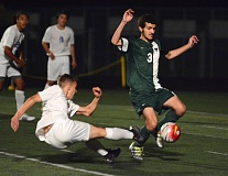 PAMPLIN MEDIA GROUP: DAVID BALL - Tigard High School defender Ryan Dexheimer (3) rushes across the box to deflect a shot by Barlow's Brody Reid.