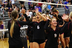 DAN BROOD - Members of the Sherwood High School volleyball team celebrate following the team's sweep against Newberg on Tuesday.
