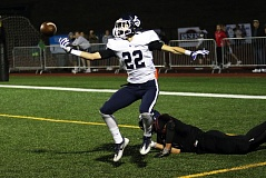 DAN BROOD - Lake Oswego senior Drew Casebeer bats the ball up before grabbing it for his first of three interceptions during the Lakers' 42-21 win over Tualatin.