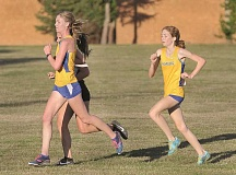 GRAPHIC PHOTO: SETH GORDON - Newberg senior Grace Hanna and freshman Abigail Hein pulled away in the final 800 meters in an 18-45 victory over Sherwood at Newberg High School Sept. 28. The Tigers improved to 4-2 in dual meets.