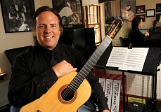 FILE PHOTO: VERN UYETAKE - Williams Jenks, proprietor of Portland Classic Guitar, shares his love of classical guitar with the community through classes and concerts.