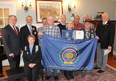 REVIEW PHOTO: ANTHONY MACUK - Ten local veterans are joined by Tualatin Chapter Regent Marilyn Olson (center) after a ceremony Monday to commemorate their service in the Vietnam War.
