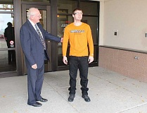 HOLLY M. GILL - Garry Vineyard, right, squints as he walks out of the jail on Monday, accompanied by his attorney, Dave Glenn.