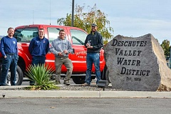 PHOTO BY LINDA LARSON - From left, Andy Bayless and Kasey Skaar, of the Jefferson County Fire Department, present Scott Surgeon and Aaron Anderson, of Deschutes Valley Water District, for their quick action in putting out a vehicle fire in August. Bryce Vincent, who also helped extinguish the fire, was not present.