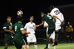 DAN BROOD - Tigard High School junior Cesar Ochoa-Navarra (5) and Sherwood High School junior Garrett Hite (20) both go up in an attempt to get their head on a Tiger corner kick during Tuesday's match. The Bowmen came away with a 1-0 victory to move to 2-0 in league play.