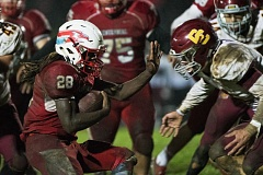 OUTLOOK PHOTO: JOSH KULLA - Centennial running back Jesse Porter picks up yardage against Central Catholic Friday, as the Eagles snapped the Rams' 43-game league winning streak.
