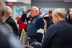 FILE - Jerry Larson salutes the flag during last year's veterans breakfast at the Juanita Pohl Center.