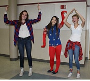 HOLLY SCHOLZ/CENTRAL OREGONIAN - Crook County High School students showed their school spirit Monday when they dressed patriotically for 'Merica' day during homecoming week activities. Pictured left to right, junior Payton Ryan, senior Monica Lopez, and junior Victoria Bates strike a USA pose in their red, white and blue outfits.