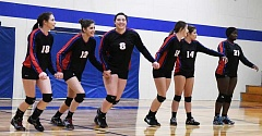 LON AUSTIN/CENTRAL OREGONIAN - Mitchell/Spray starters run toward the net following the national anthem for the start of their match against Horizon Christian. Team members are (left to right) Marissa Jacobson, Maria Rey, Mirna Daltoso, Cheyanne Collins, Cassie Moore and Shamsi Omari.