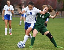 LON AUSTIN/CENTRAL OREGONIAN - Viviana Varga fights with Estacada's Ali Hart for the ball during the Cowgirls' match with the Rangers on Thursday. Estacada won 1-0 on a second-half goal.