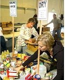 GARY ALLEN - Volunteers sort donations from a past Feed the Need food drive, which benefits the FISH food bank in Newberg. This year's event has been dubbed 'Pickup the Need' and will gather food donations at several different churches Oct. 23.