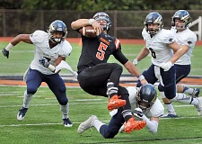 SETH GORDON - George Fox safety Rudy Hughes upends Lewis & Clark quarterback Niko Fortino during the Bruins' 52-13 victory in Portland Saturday.