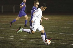 SUBMITTED PHOTO: JIM BESEDA - Wilsonville's Edgar Hernandez-Flores (with ball) is marked closely by La Salle Prep's Brendan Dexter in Tuesday's 1-1 Northwest Oregon Conference boys' soccer tie at Wilsonville's Randall Stadium.