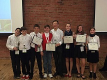 SUBMITTED PHOTO - The Lake Oswego Junior High Architecture Team celebrates an international victory at the SchoolsNEXT competition, held Sept. 28-Oct. 1 in Philadelphia. From left, Simon Roe, Nathan Griffin, Rylan Boyles, David Morgan, Ryan Miller, Sydney Blem, Abby Strege, Sammi Tessier.