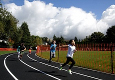 TIMES PHOTO BY JONATHAN HOUSE - Bridgeport Elementary students take their new track for a test run.