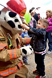 PIONEER FILE PHOTO - MFD mascot Sparky makes friends during the 2015  open house at the fire station