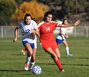 LON AUSTIN/CENTRAL OREGONIAN - Emma Hehn fights for the ball with Corbett forward Aliya Lara. Hehn beat Lara to the ball, but the Corbett Cardinals had the last word as they won the match 2-0.