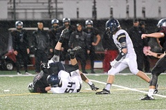 SUBMITTED PHOTO: BRIAN HUGGINS - Canby's Peter Wilmes tackles a Tualatin ball carrier during the Cougars 21-19 win Friday, Oct. 14.