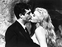 COURTESY: ASTOR PICTURES - Shawn Levy's book explores 1950s Rome, depicted in movies such as 'La Dolce Vita' (1960) with Marcello Mastroianni and Anita Ekberg with 'The Kiss.'