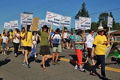 PAMPLIN MEDIA GROUP PHOTO: KELSEY O'HALLORAN - At the Aug. 20 Multnomah Days parade, community members march in protest of proposed density increases in their neighborhood.