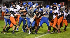 LON AUSTIN/CENTRAL OREGONIAN - The Crook County offensive line and fullback Jacob Kasberger (4) work to hold their blocks as the Cowboys attempt to run a play up the middle. Crook County made a short gain on the play, while Gladstone won the game 70-12.