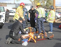 SUSAN MATHENY - Fire personnel and emergency medical technicians attend to two wounded victims from the mock active shooter drill held at the old courthouse Oct. 17. The event included eight law enforcement and rescue agencies, as well as observers from the FBI and St. Charles Madras.