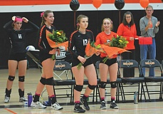 SPOTLIGHT PHOTO: JAKE MCNEAL - The Indians celebrated Kaylie Kopra, Rosie Sykes (12) and Alyssa Spang (6) before their 3-1 (25-15, 15-25, 25-22, 25-12) Senior Night defeat of Astoria on Tuesday.