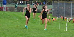 TIMES PHOTO: MATT SINGLEDECKER - Jesuit freshman Alexis Kebbe (right) and Makenna Schumacher (left) took first and second place overall against Beaverton and Aloha.