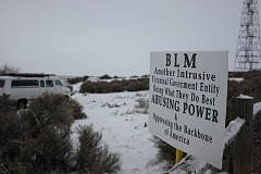 TRIBUNE FILE PHOTO - Signs posted outside the Malheur National Wildlife Refuge south of Burns in Janauary spelled out the occupiers' feelings about government agencies. A federal jury will decide the fate of seven people involved in the occupation.
