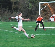 CONNER WILLIAMS / MOLALLA PIONEER  - Molalla senior Meagan Routley winds up to take a shot against Crook County on OCt. 18, but hits the right post. She would later score in the second half.