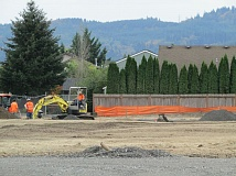 Heavy equipment transfers material on a development site in a residential area near Icenogle Loop in Scappoose. A new ordinance proposes to reduce construction hours from 7 a.m. to 7 p.m. to reduce impact to neighborhoods.