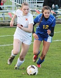 PHOTO COURTESY OF CONNER WILLIAMS/MOLALLA PIONEER - Emma Hehn, right, and Molalla's Meagan Routely battle for the ball during the first half of the Cowgirls' 8-0 loss to the Indians on Tuesday.