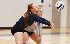 LON AUSTIN/CENTRAL OREGONIAN - Jennifer McCallister and Aspen Christiansen receive a serve during the Cowgirls' win over the Madras White Buffalos on Tuesday. The two seniors helped lead the Cowgirls to a straight-set victory over the White Buffalos.