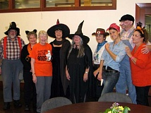 SUBMITTED PHOTO - Don your favorite spooky or political costume for the costume contest on Halloween. This photo shows the costumes popular in 2014.