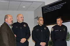 THE TIMES: MANDY FEDER-SAWYER - From left: Beaverton Mayor Denny Doyle welcomes new Beaverton Police Officers Brian Loose, Josh Mundell and Shane Shoemaker during a swearing in ceremony on Oct. 18 at the city council meeting.