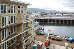 PORTLAND TRIBUNE: JONATHAN HOUSE - Commissioner Nick Fish wants the City Council to put Terminal 1 -- seen here from a nearby residential project -- back up for sale.