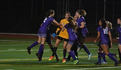 TIMES PHOTO: MATT SINGLEDECKER - The Sunset girls soccer team celebrates its 2-1 win over Jesuit in the Class 6A semifinals on Tuesday.